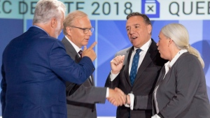 Quebec's political leaders shake hands at the start of the first televised English-language debate