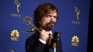 Peter Dinklage poses in the press room with the award for outstanding supporting actor in a drama series for 'Game of Thrones' at the 70th Primetime Emmy Awards on Monday, Sept. 17, 2018, at the Microsoft Theater in Los Angeles. (Photo by Jordan Strauss/Invision/AP)