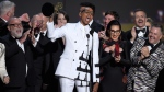 "RuPaul Charles, center, and the team from ""RuPaul's Drag Race"" accept the award for outstanding reality/competition program at the 70th Primetime Emmy Awards on Monday, Sept. 17, 2018, at the Microsoft Theater in Los Angeles. (Photo by Chris Pizzello/Invision/AP)"