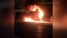 Flames engulf the back of an OC Transpo bus while it was traveling eastbound on the Queensway Monday night. Witnesses say no one was injured. (Facebook: Kayla Madere)