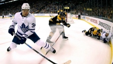 In this April 14, 2018, file photo shot with a fisheye lens, Toronto Maple Leafs' Auston Matthews (34) keeps the puck from Boston Bruins' Rick Nash (61) during the first period of Game 2 of an NHL hockey first-round playoff series in Boston. The Maple Leafs have not had a captain since trading Dion Phaneuf in early 2016. (AP Photo/Winslow Townson, File)