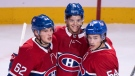 Montreal Canadiens' Jesperi Kotkaniemi, centre, celebrates his goal with teammates Artturi Lehkonen, left, and Charles Hudon as they face the New Jersey Devils during third period pre-season NHL hockey action Monday, September 17, 2018 in Montreal. THE CANADIAN PRESS/Paul Chiasson