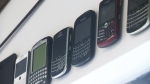 BlackBerry devices line the wall of ForeQuarter Butcher Shop in Kitchener, Ont.