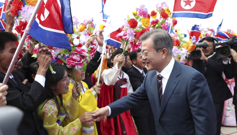 South Korean President Moon Jae-in, right, is greeted by North Koreans during a welcome ceremony at Sunan International Airport in Pyongyang, North Korea, on Sept. 18, 2018. (Pyongyang Press Corps Pool via AP)