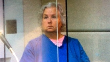 FILE - In this Sept. 6, 2018, screen shot from video during her court appearance, Nancy Brophy appears in Multnomah County Circuit Court in Portland, Ore. The self-published romance writer being held in her husband's death has now been indicted on a murder charge. (Multnomah County Circuit Court /The Oregonian via AP, File)