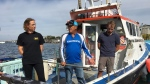 For the first time in Atlantic Canadian waters, scientists have successfully tagged a great white shark. Dr. Heather Bowlby, left, researcher with the Bedford Institute of Oceanography, Art Gaetan, centre, skipper of Blue Shark Charters, and Nathan Glenn, first mate of Blue Shark Charters, speak to media on a company boat in Eastern Passage, N.S., on Tuesday, Sept. 18, 2018. (THE CANADIAN PRESS/Aly Thomson)