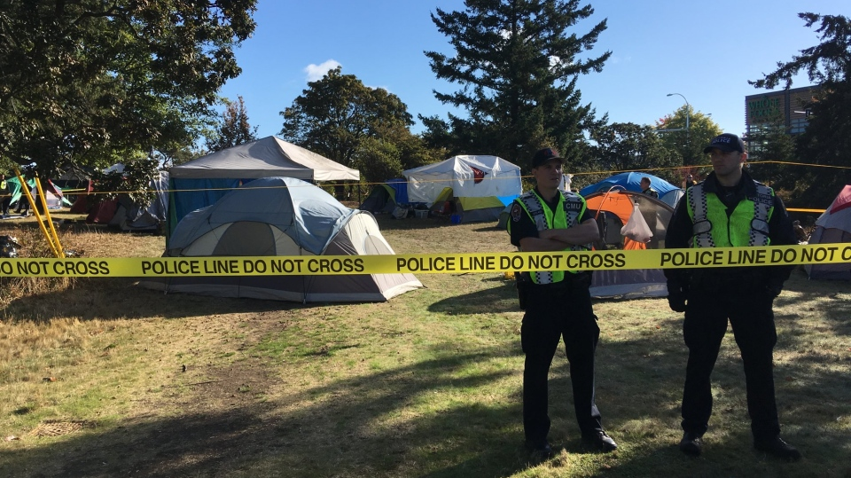 Saanich police cordoned off a growing tent city on Ministry of Transportation land as campers were told to clear out. Sept. 18, 2018. (@SaanichPolice)