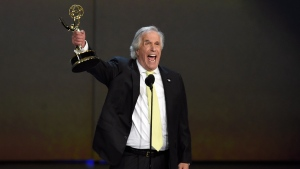 "Henry Winkler accepts the award for outstanding supporting actor in a comedy series for ""Barry"" at the 70th Primetime Emmy Awards on Monday, Sept. 17, 2018, at the Microsoft Theater in Los Angeles. (Photo by Chris Pizzello/Invision/AP)"