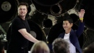 FILE - SpaceX founder and chief executive Elon Musk, left, shakes hands with Japanese billionaire Yusaku Maezawa, right, after announcing him as the first private passenger on a trip around the moon, Monday, Sept. 17, 2018, in Hawthorne, Calif. (AP Photo/Chris Carlson)