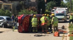 A woman had to be extracted from her vehicle after it flipped in a crash.