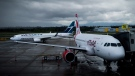 A Westjet Boeing 737-800, left, taxis past an Air Canada Rouge Airbus A319 at Vancouver International Airport in Richmond, B.C., on Monday, April 28, 2014. THE CANADIAN PRESS/Darryl Dyck