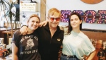 Elton John poses with Sonic Boom record store employees Lauren Mayer, left, and Ali Haberstroh in Toronto in this photo from Sonic Boom's twitter page. (@SonicBoomMusic/Twitter)