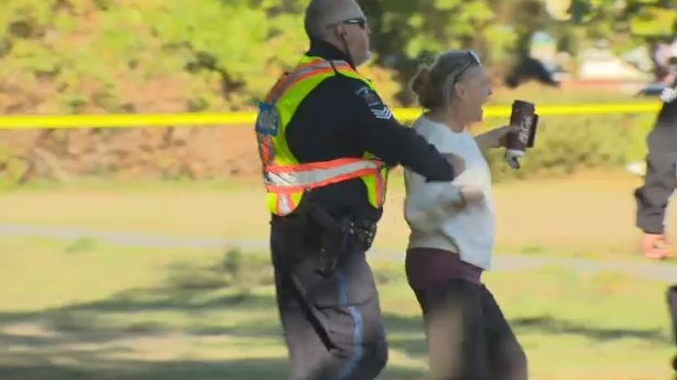 A woman who is not a resident of the encampment was arrested without incident for crossing police lines. Sept. 18, 2018. (CTV Vancouver Island)