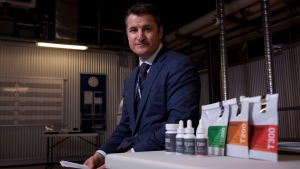 Tilray President Brendan Kennedy is photographed with some of the Tilray product line such as capsules, oils, and dried marijuana at head office in Nanaimo, B.C., on Thursday, November 29, 2017. (THE CANADIAN PRESS/Chad Hipolito)