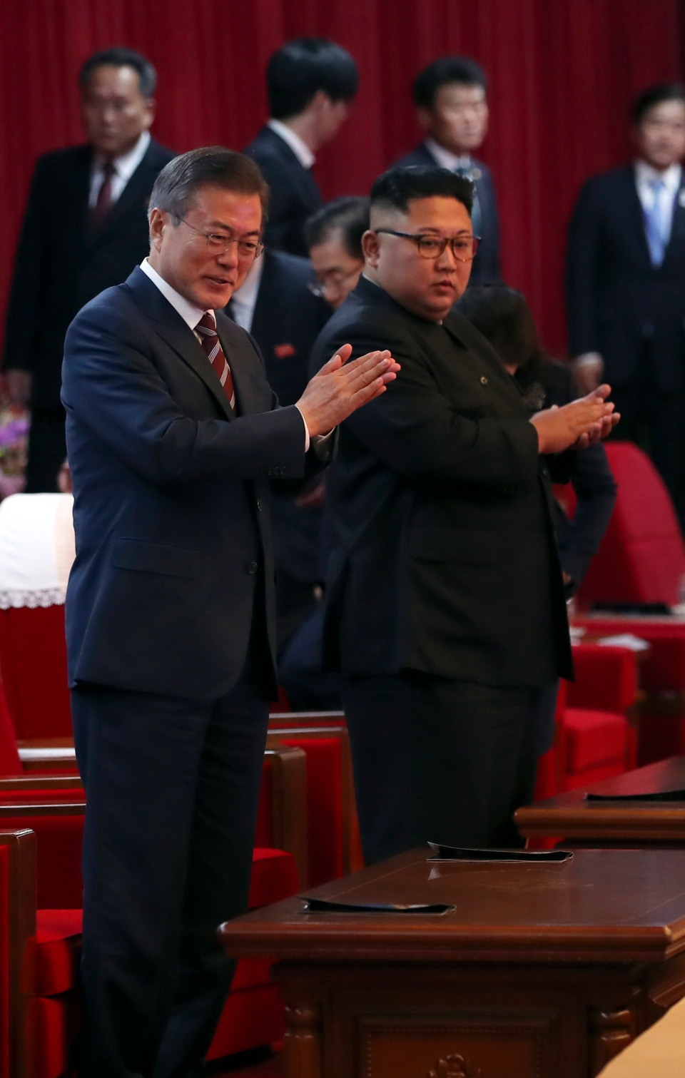 South Korean President Moon Jae-in, left, and North Korean leader Kim Jong Un arrive at the Pyongyang Grand Theatre in Pyongyang, North Korea, Tuesday, Sept. 18, 2018. (Pyongyang Press Corps Pool via AP)