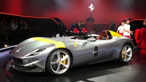 The Ferrari Monza SP1 is displayed in Maranello, Italy, Tuesday, Sept. 18, 2018. (AP Photo/Collen Barry)