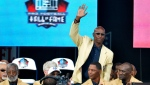 In this Aug. 2, 2014, file photo, enshrinee Eric Dickerson is introduced during the Pro Football Hall of Fame enshrinement ceremony, in Canton, Ohio. A group of Pro Football Hall of Famers is demanding health insurance coverage and a share of NFL revenues or else those former players will boycott the induction ceremonies. (AP Photo/David Richard, File)