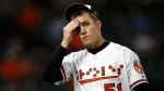 Baltimore Orioles relief pitcher Paul Fry walks off the field after the seventh inning of a baseball game against the Toronto Blue Jays, Tuesday, Sept. 18, 2018, in Baltimore. Toronto scored four runs against Fry in the seventh, and went on to win 6-4. (AP Photo/Patrick Semansky)
