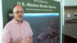 "In this Friday, Sept. 14, 2018, photo, Kenneth Madsen, an Ohio State University-Newark geography professor and border wall expert, discusses his photo exhibit of border wall pictures and maps, ""Up Close with U.S.-Mexico Border Barriers,"" in Newark, Ohio. Madsen says the goal of his exhibit, opening Wednesday, Sept. 19 is to raise awareness about an issue that most people have only seen on the news. (AP Photo/Andrew Welsh-Huggins)"