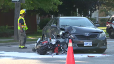 Motorcyclist taken to hospital after colliding with a car.