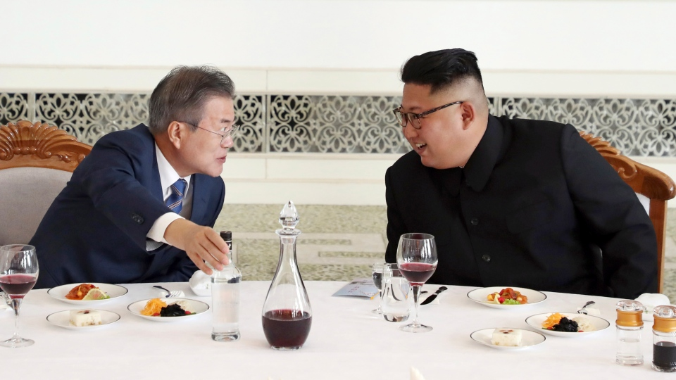 South Korean President Moon Jae-in, left, talks with North Korean leader Kim Jong Un at Okryu-Gwan restaurant in Pyongyang, North Korea, Wednesday, Sept. 19, 2018. (Pyongyang Press Corps Pool via AP)
