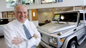 In this April 25, 2006, file photo, Mike Jackson, Chairman and Chief Executive Officer of AutoNation, poses at Mercedes-Benz of Fort Lauderdale in Fort Lauderdale, Fla. AutoNation's longtime CEO Jackson is stepping down from the automotive retailer. (AP Photo/Wilfredo Lee, File)