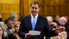 Conservative Leader Andrew Scheer stands during question period in the House of Commons on Parliament Hill in Ottawa on Monday, Sept. 17, 2018. THE CANADIAN PRESS/Sean Kilpatrick