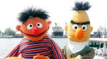 """FILE - In this May 9, 2006, file photo, Ernie and Bert of """"Sesame Street"""" pose in front of the Queen Mary II in the harbor of Hamburg, Germany. The producers of """"Sesame Street"""" tweeted Tuesday, Sept. 18, 2018, that Bert and Ernie are not gay in response to a Queerty interview published Sunday, Sept. 16, 2018, with a former writer for the show who said he considered the puppets lovers. (AP Photo/Fabian Bimmer, File)"""