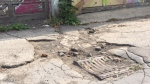 The City of Toronto won't fix a potholed downtown laneway that has gone unmaintained for years despite resident pleas because it is private and owned by a man who died in 1900, the city said. (Malcolm Fox)