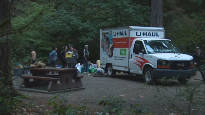 Campers packed their belongings out of U-Haul trailers and into camp sites at Goldstream Provincial Park Tues., Sept. 18, 2018. (CTV Vancouver Island)