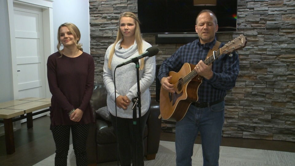 Steve Patterson and his two daughters, Lauren and Taylor, perform