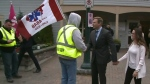 Persistent protesters confront N.B. Liberal leader
