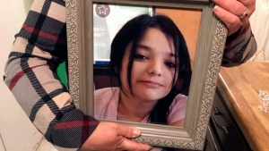 Maria Cristina Benevidez holds a photograph of her daughter, Melissa Ramirez, at her home in Rio Bravo, Texas. Ramirez is one of four women authorities say were killed by a Border Patrol supervisor. (AP Photo/Susan Montoya Bryan)