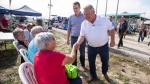 Ontario Premier Doug Ford shakes hands with people as Ontario Minister of Infrastructure Monte McNaughton looks on at the International Plowing Match in Pain Court Ont., on Tuesday, September 18, 2018. (THE CANADIAN PRESS/ Geoff Robins)