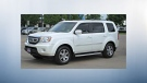 The three armed thieves fled the scene in this 2011 white Honda Pilot. (Supplied)