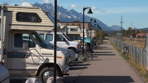 Trailers gather in a parking lot in Canmore, Alta., the most expensive place to live in the province.