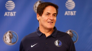In this Feb. 26, 2018, file photo, Dallas Mavericks owner Mark Cuban stands on stage before an NBA basketball press conference in Dallas. (AP Photo/Ron Jenkins, File)