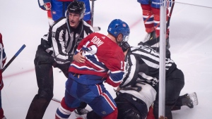 Montreal Canadiens' Max Domi is pulled away by linesman Ryan Daisy after a brief fight with Florida Panthers' Aaron Ekblad during third period NHL hockey action in Montreal on Wednesday, September 19, 2018. THE CANADIAN PRESS/Paul Chiasson