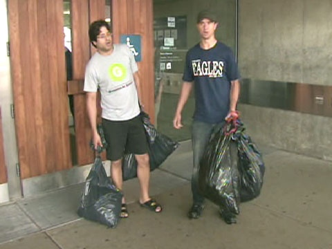 Govind Rao (left) of the Friends of Christie Pits attempted to drop off garbage at city hall on Monday, June 29, 2009.