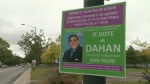 Posters for Independent candidate Ali Dehan were shot in Quebec City, leading to charges against one man.