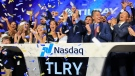 Brendan Kennedy, third from right in front, CEO and founder of British Columbia-based Tilray Inc., a major Canadian marijuana grower, leads cheers as confetti falls to celebrate his company's IPO (TLRY) at Nasdaq, Thursday, July 19, 2018, in New York. Medical marijuana is legal in Canada, and on Oct. 17, the country will become the first major industrialized nation to legalize its production and sale for recreational use. (AP Photo/Bebeto Matthews)
