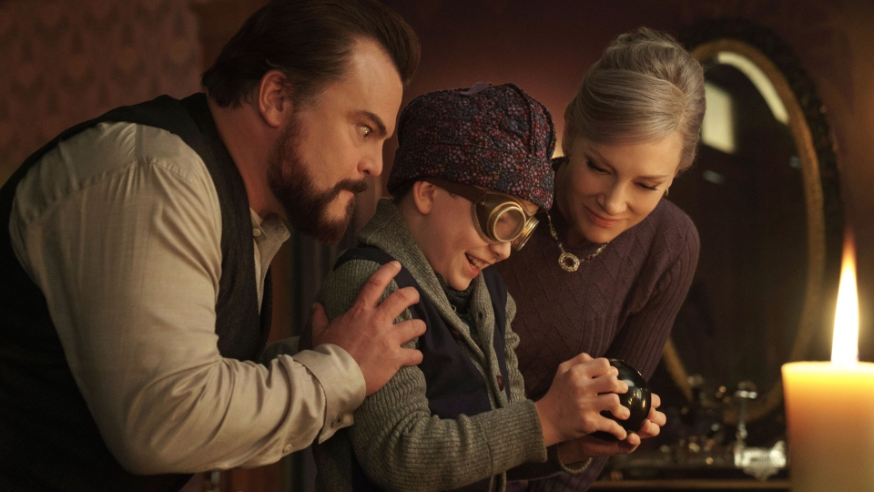 Jack Black, from left, Owen Vaccaro and Cate Blanchett in a scene from 'The House With A Clock in Its Walls.' (Quantrell D. Colbert/Universal Pictures via AP)