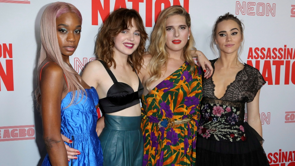 Abra, from left, Odessa Young, Hari Nef and Suki Waterhouse, members of the cast, arrive at the L.A. premiere of  'Assassination Nation' on Sept. 12, 2018. (Willy Sanjuan / Invision / AP)