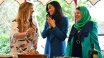 Meghan, the Duchess of Sussex, centre reacts with unidentified women involved with the cookbook 'Together' during a reception at Kensington Palace, in London, Thursday Sept. 20, 2018. (Ben Stansall/Pool Photo via AP)