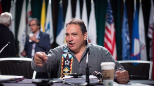 Assembly of First Nations National Chief Perry Bellegarde speaks with a delegate during the AFN annual general assembly, in Vancouver on Thursday, July 26, 2018. THE CANADIAN PRESS/Darryl Dyck
