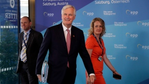 EU chief Brexit negotiator Michel Barnier, centre, arrives at the informal EU summit in Salzburg, Austria, Wednesday, Sept. 19, 2018. (AP Photo/Matthias Schrader)