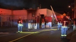 Authorities are trying to identify two drivers who ran over a fire hose as crews battled a blaze in East Vancouver Thursday.
