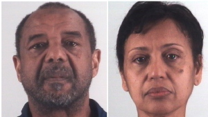 This combination of photos provided by the Tarrant County Sheriff's Department in Texas shows Mohamed Toure, left, and Denise Cros-Toure, a Fort Worth couple accused of enslaving a Guinean woman for 16 years. (Tarrant County Sheriff's Department via AP)