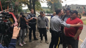 Supporters of tent city occupants clashed with neighbours of Goldstream Park after Mounties moved to shut down the latest encampment. Sept. 20, 2018. (CTV Vancouver Island)