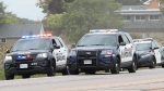 Police officers engage in a high-speed chase down Highway 401 after a fatal shooting in Kitchener. (Andrew Collins)